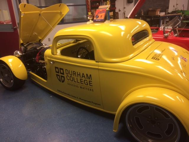 Yellow kit car built by students in the automotive trade at Durham College