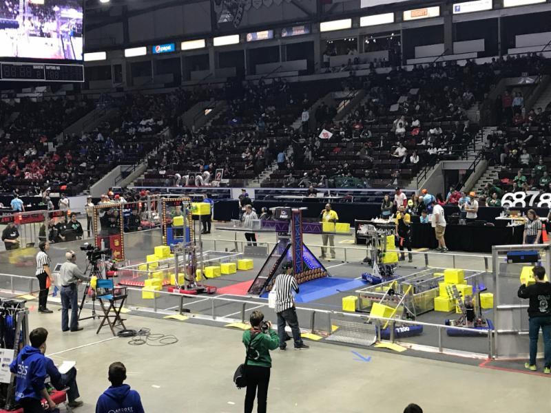 High school student getting ready to show what their robot can do on the arena floor