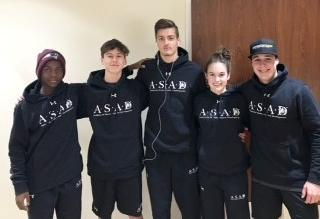 Male and female students wearing ASAD hoodies