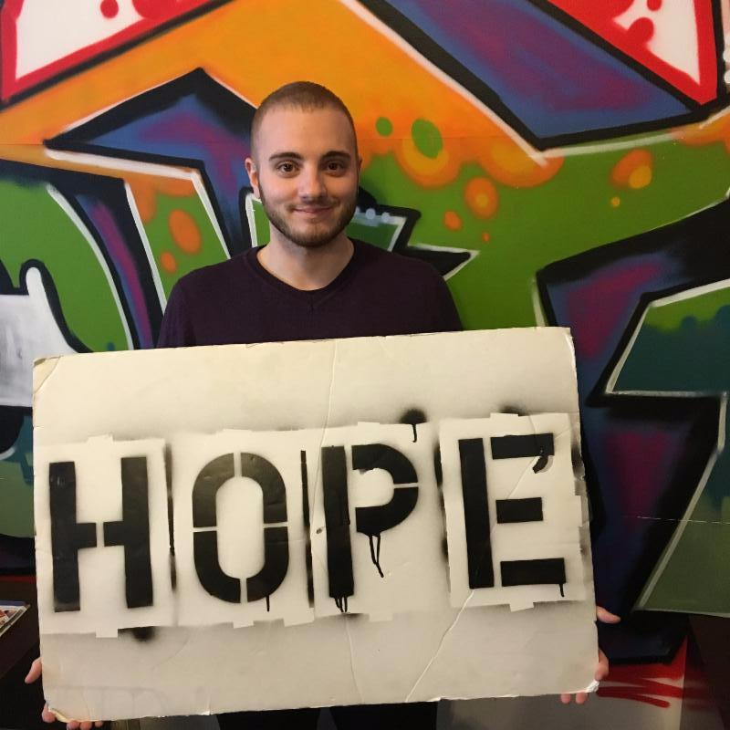 Photo of Brennan Williams holding the hope board