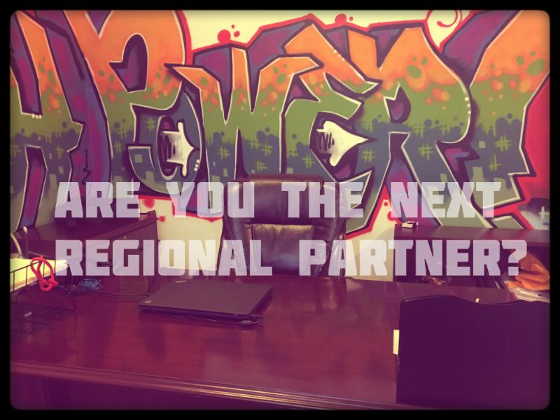 image of desk with empty chair in front of YP office graffiti. Are you the Next Regional Youth Partner is written across the image