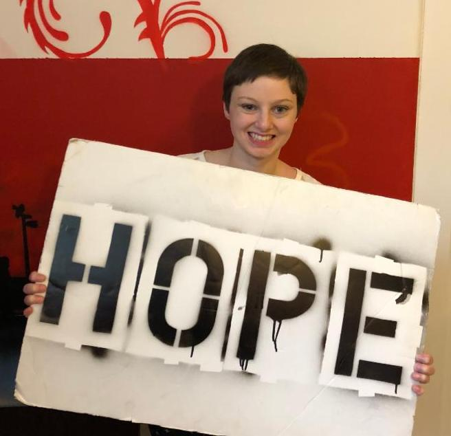 Carly holding the hope board