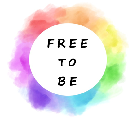 watercolor rainbow with a white circle in the middle and text that reads Free to Be