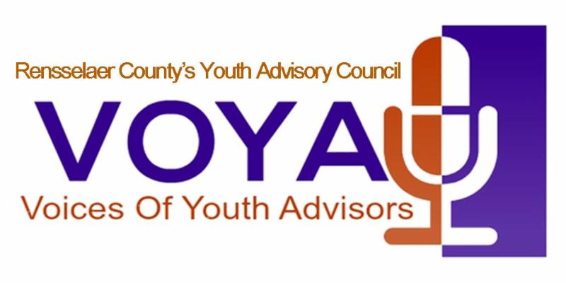 VOYA _Voices of Youth Advisors_ logo. At the tops says _Rensselaer County_s Youth Advisory Council._ Underneath that says _VOYA._ Undeneath VOYA states _Voices of Youth Advisors_ Orange and purple microphone is place to the right of the text.