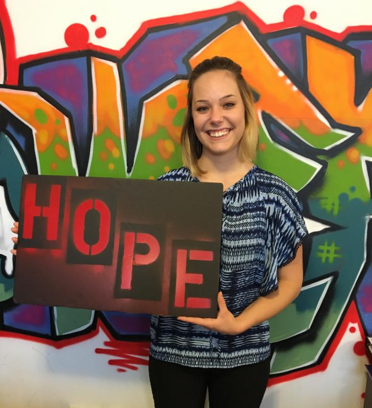 Amanda Davidson holding the hope board in the YP! office