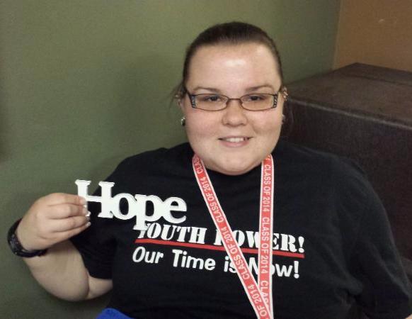 Bianca Logan holding a hope sign