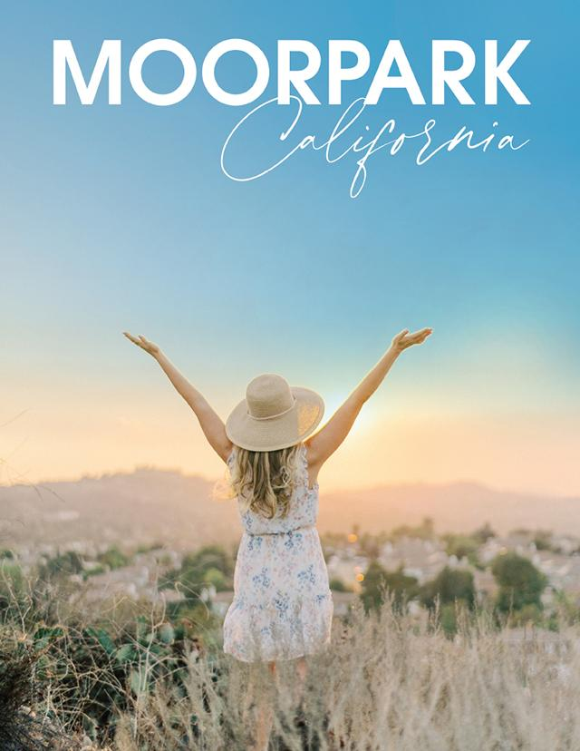 Woman with arms in the air overlooking Moorpark