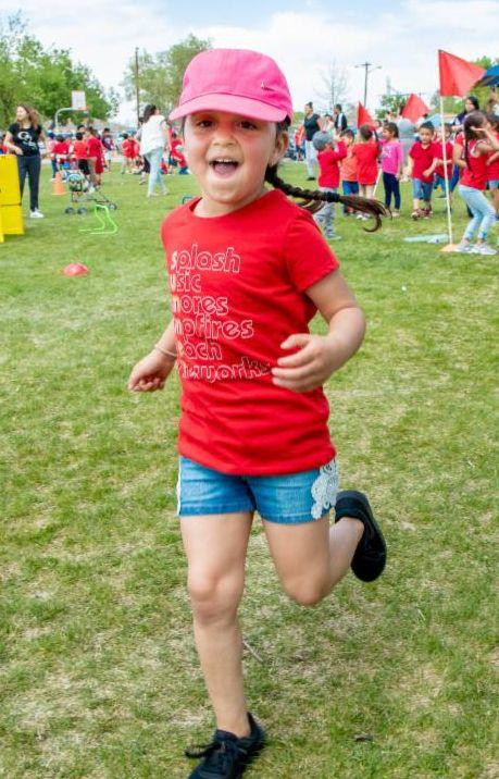 Student running at Newlon Elementary