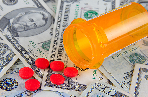 pills and dollar bills image to accompany article