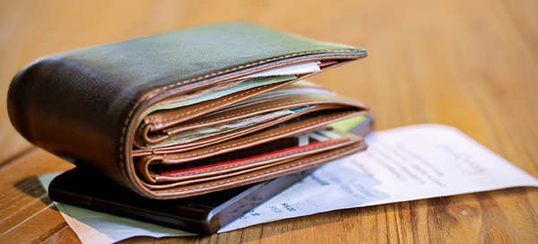 Photo of wallet overstuffed with receipts