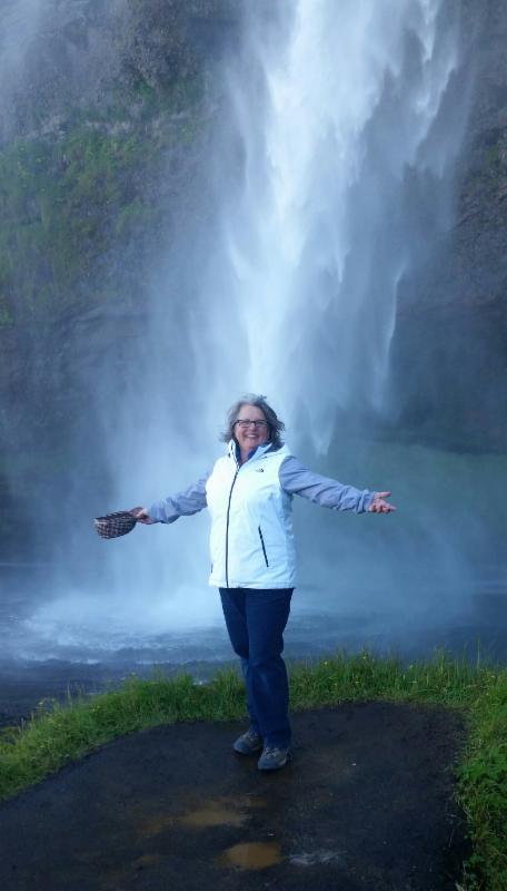 Joan Plisko in front of waterfall in Iceland