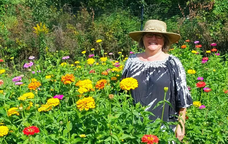 Joan Plisko in field of zinnias