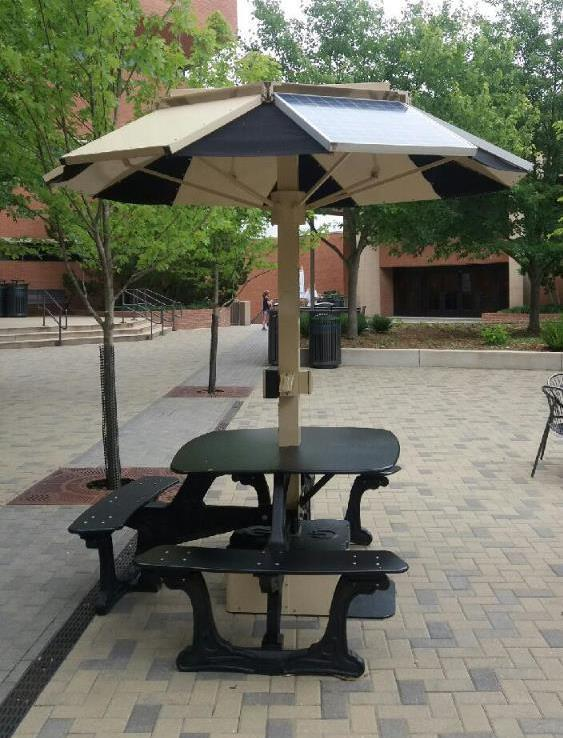 Solar powered charging table