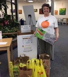 Peggy Baggaley picks up MEND summer library food drive groceries