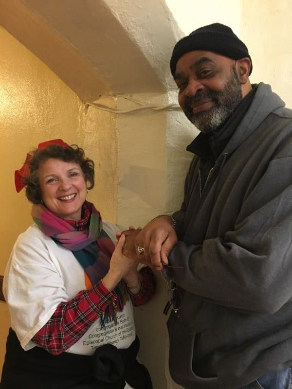 Peggy Baggaley warms William Johnson's hands