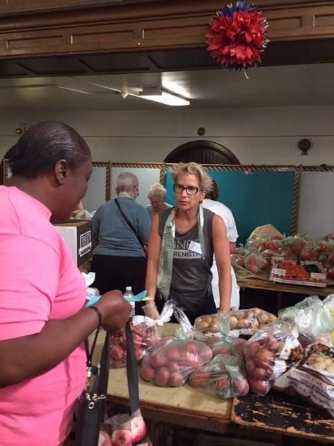 Amy Goldman distributes tomatoes