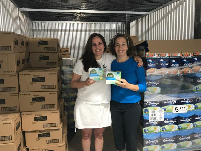 Elise Joy of GHGP provides tampons to IFPO