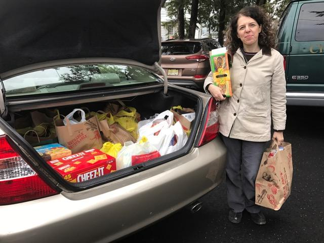 Natasha Benitsky of Kol Rina delivers food to IFPO