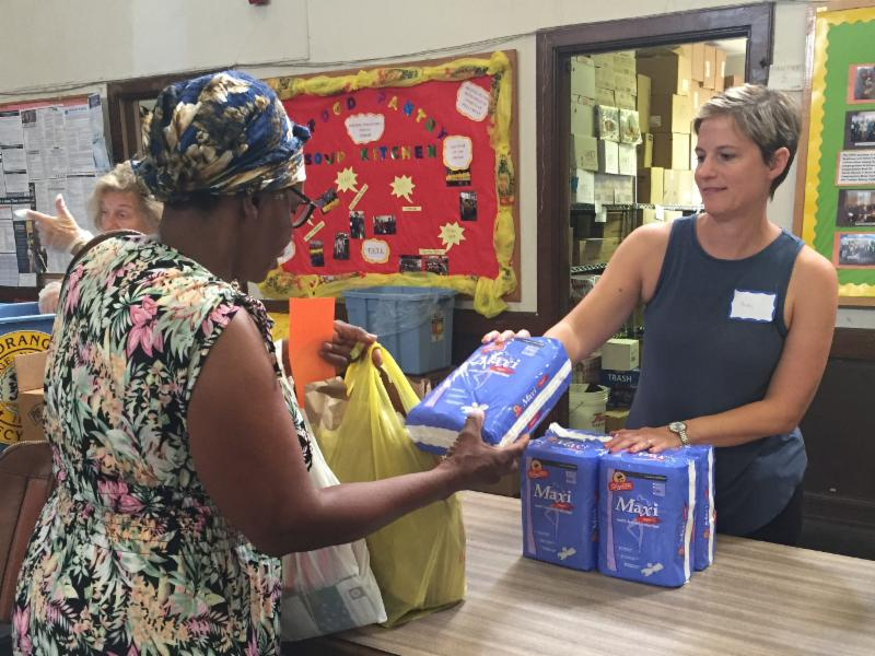 Kristin Sterling distributes pads for NCJW Period Project