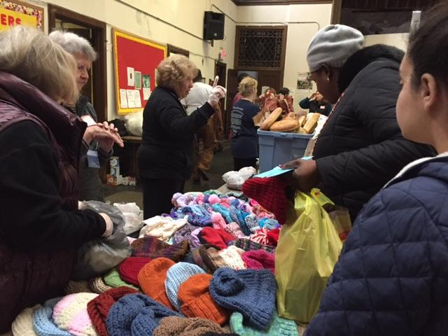 Knitted hats from Catholic Charities helped provide warmth
