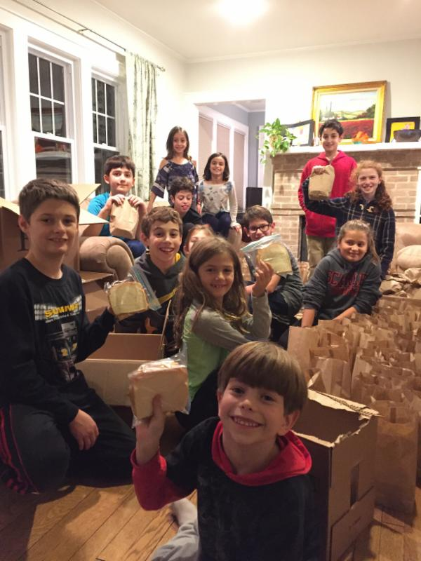 Kids making bag lunches