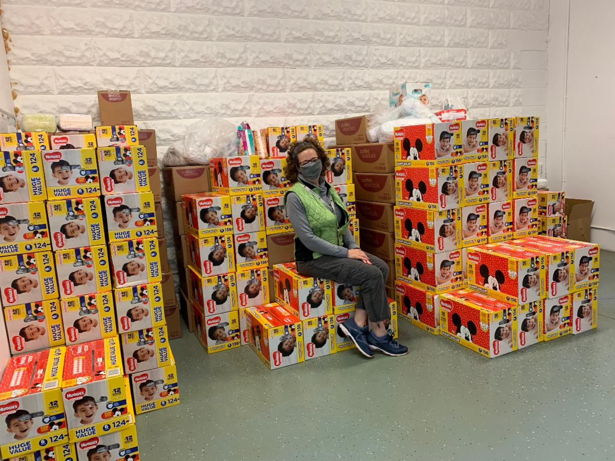 Karyn Boosin Leit with diapers in our new space