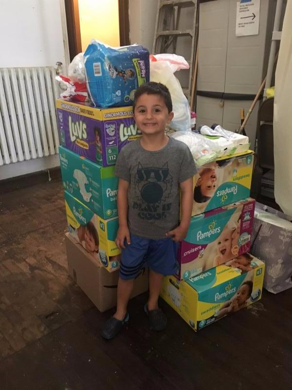 Justin Sparaga, age 6, delivers 2,003 diapers from his Drive