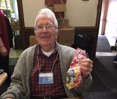 Christ Church volunteer hands out Valentine's bags