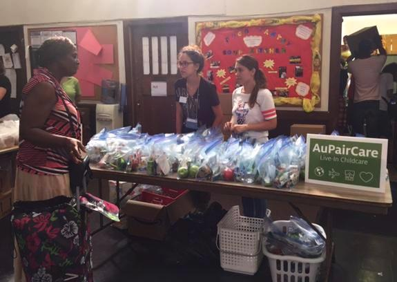 Au Pairs hand out snacks for international exchange