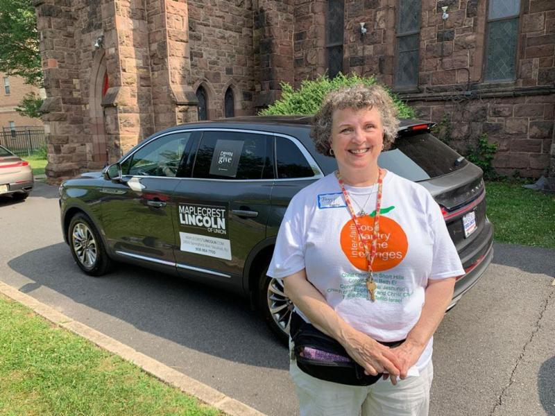 Peggy Baggaley prepares to test drive a Lincol