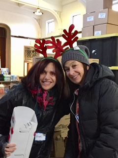 Anne Sussman and Janet Schwamm at Xmas distribution