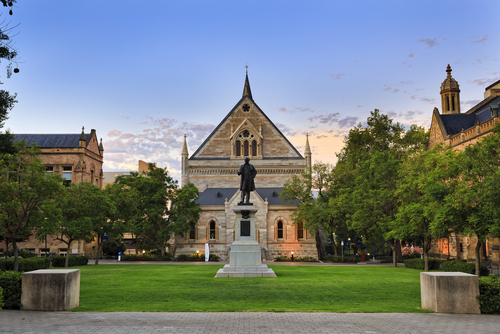 facade of classical gothic building and monument statue of University of Adelaide in South Australia