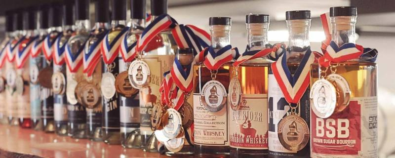 Heritage Distilling Co. bottles with awards