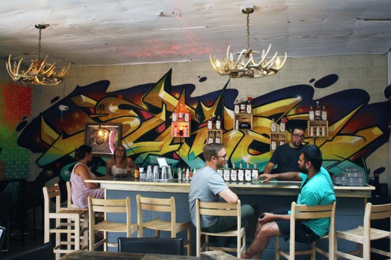 Customers sit in the State 38 tasting room in RiNo