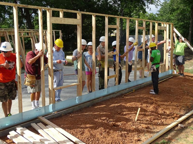 Raising a wall Zuniga home