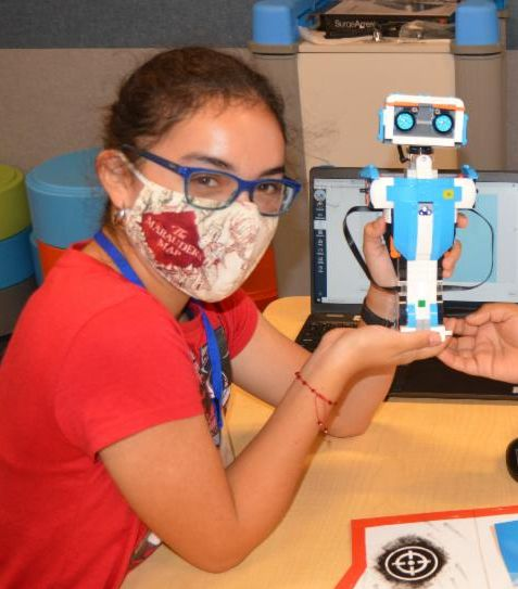girl holding robot
