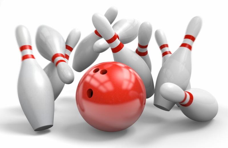 Bowling pins falling down from a strike in ten-pin bowling.