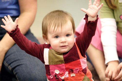 Child Raising her Arms!