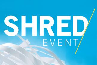 Light blue background with the words Shred event in white letters and a small pile of white shredded paper in the lower left corner.