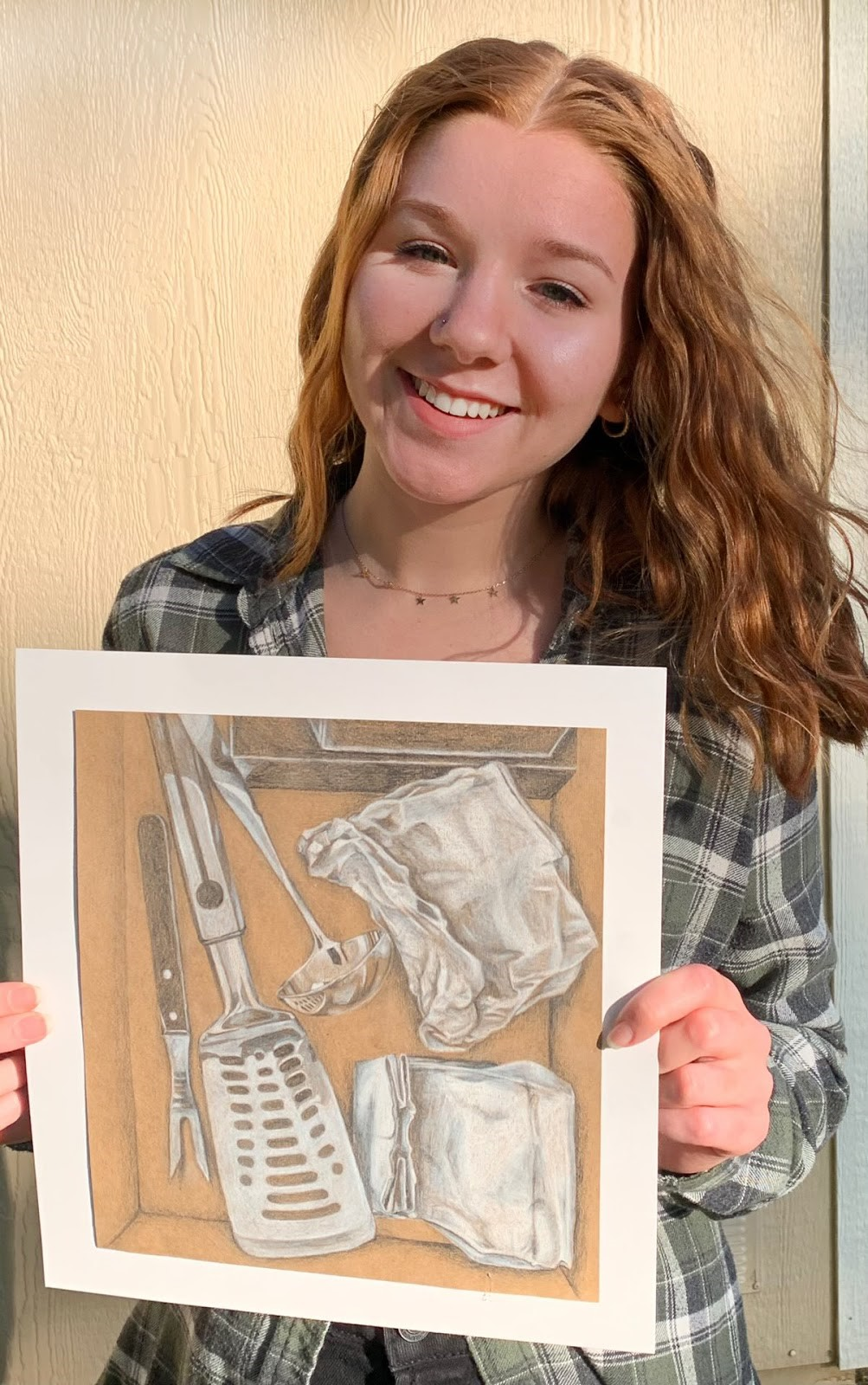 RHS Senior Alexa Hernandez with a picture of her artwork.
