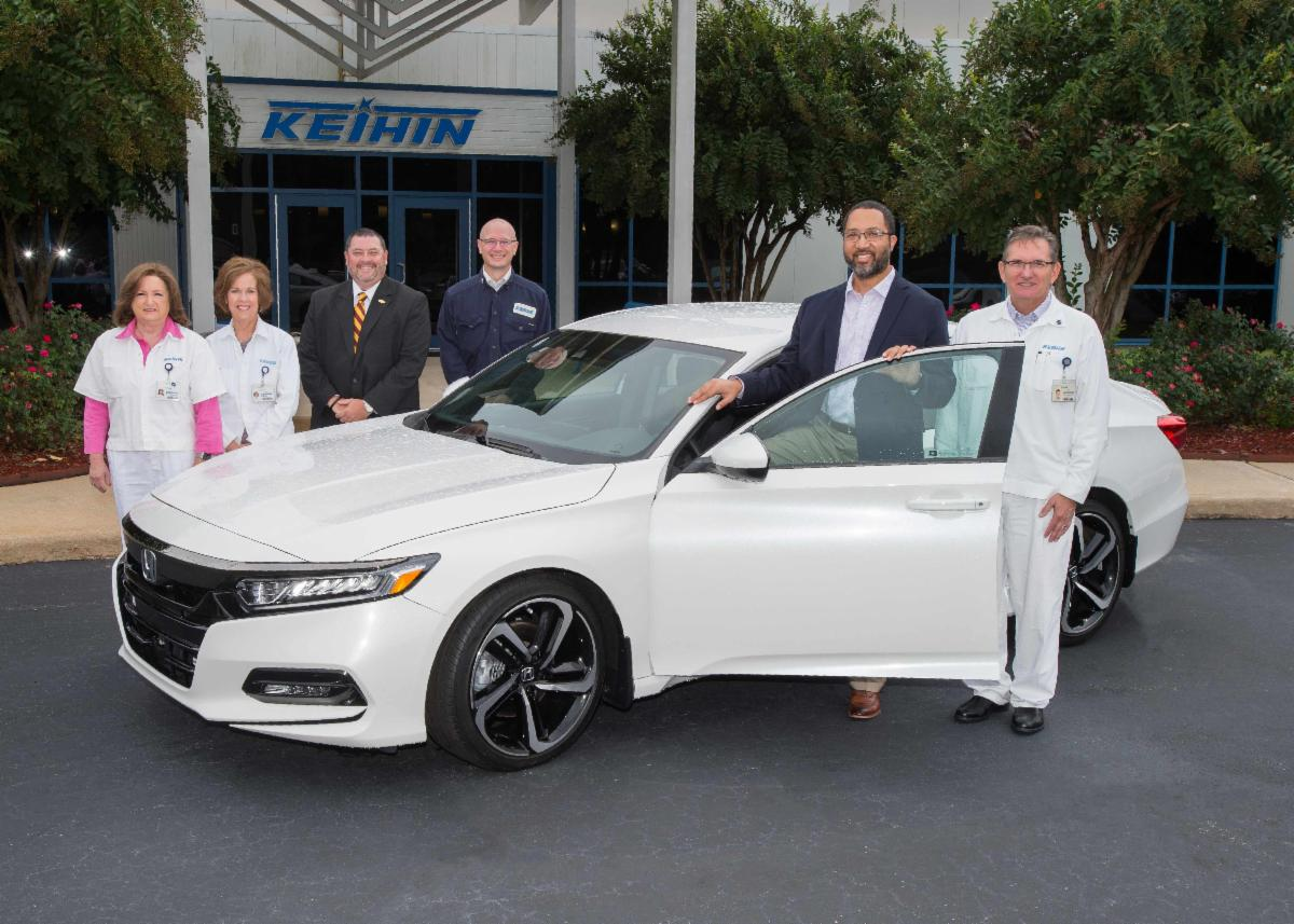 Dr. McLeod_ Lynwood Roberson_ Keihin employees pose with Honda