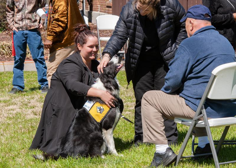 Therapy dog Chief and students