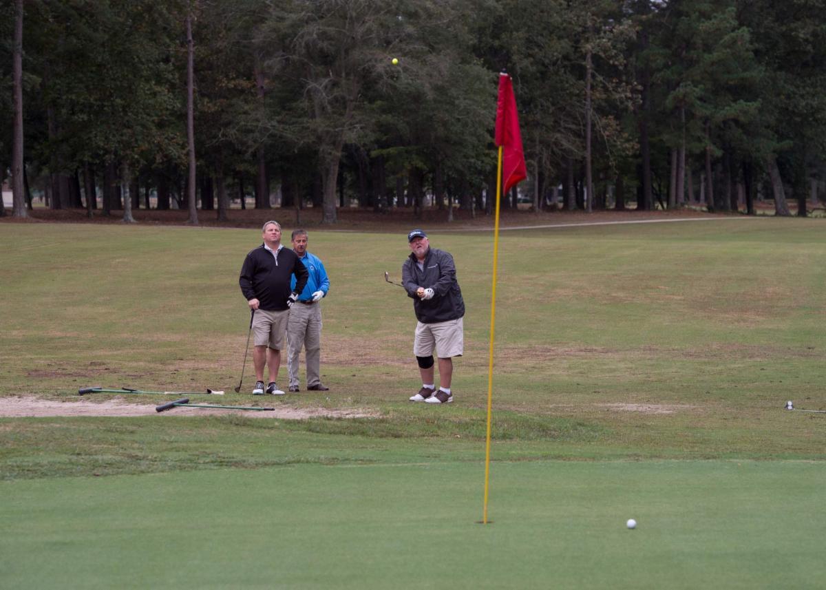 Golf team at putting green