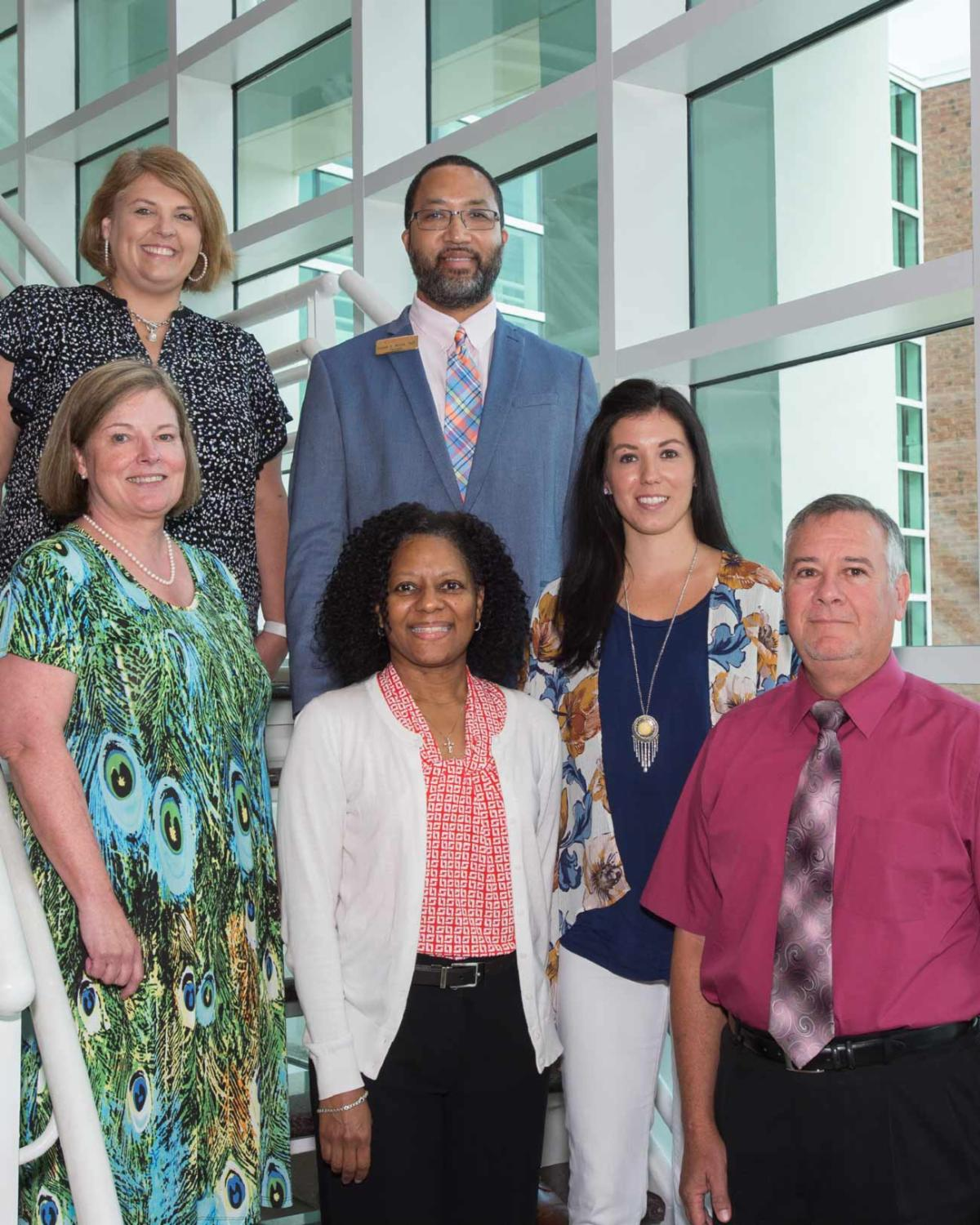 New ECC Foundation Board members pose on staircase