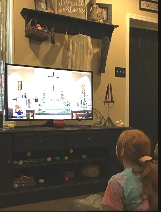 Girl watches SJC TV Mass