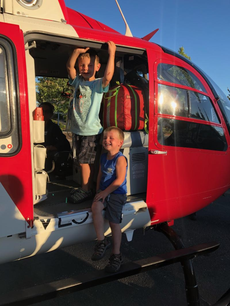 Corbin and Jackson Lamb check out Airlift Northwest's helicopter