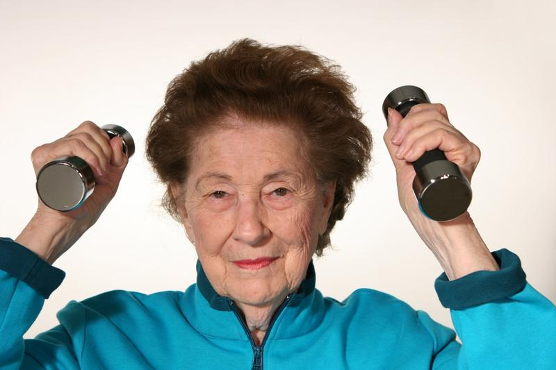 older woman with weights