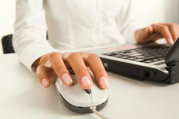 Person at a computer using a computer mouse
