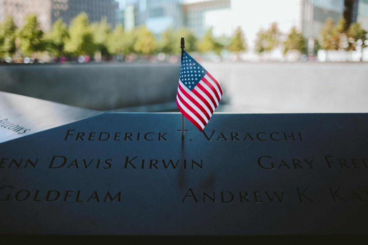 Picture of American flag near a memorial stone