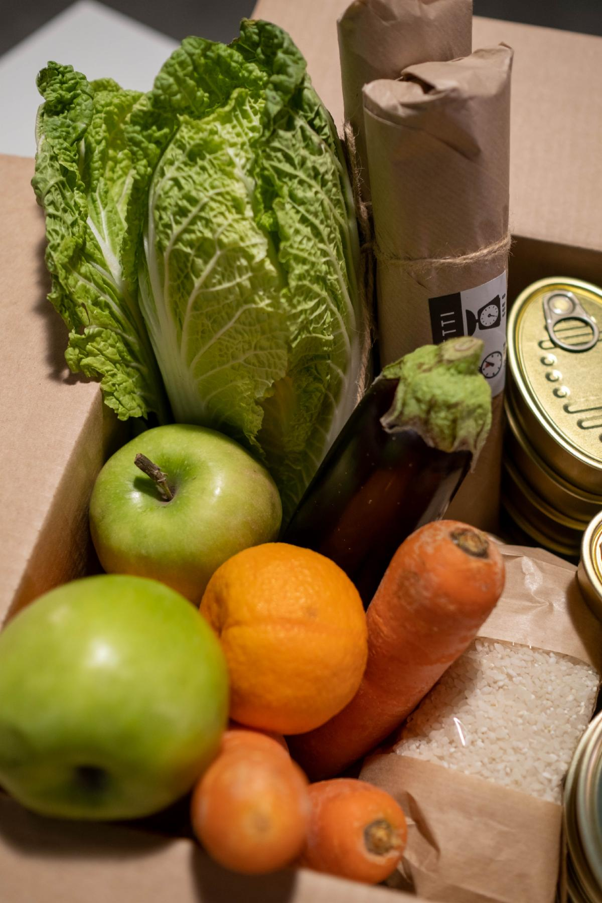 Vegetables and canned goods in a box